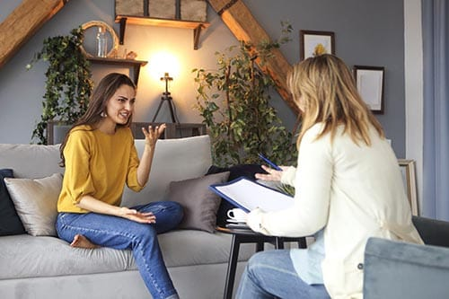 woman speaking with her therapist at Midwest Center at Youngstown